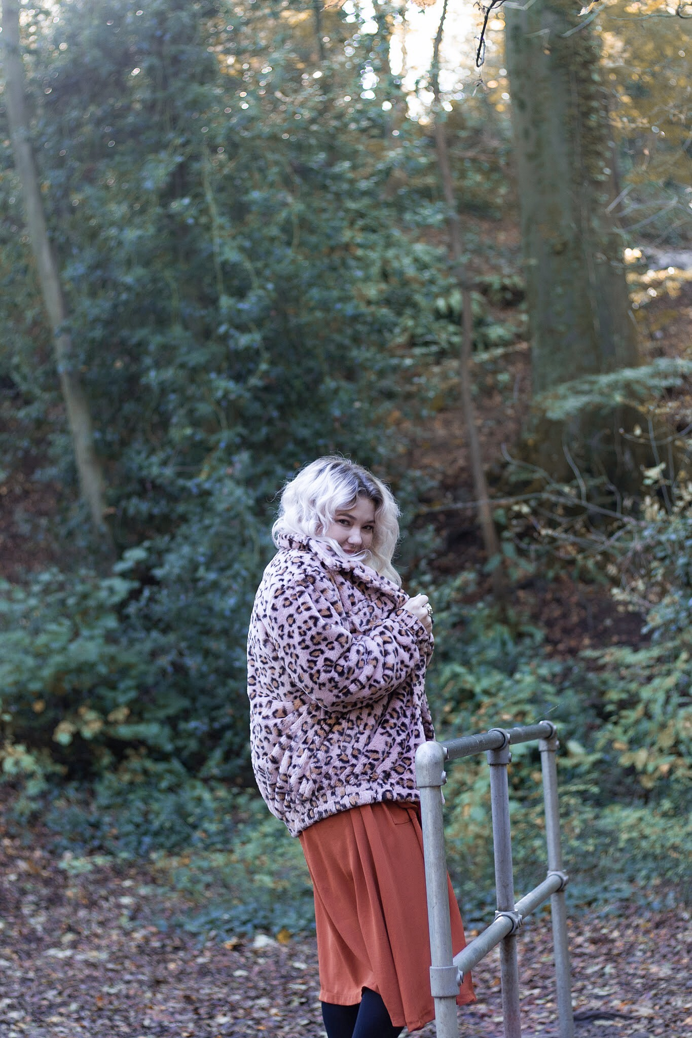 Blonde woman in leopard print coat
