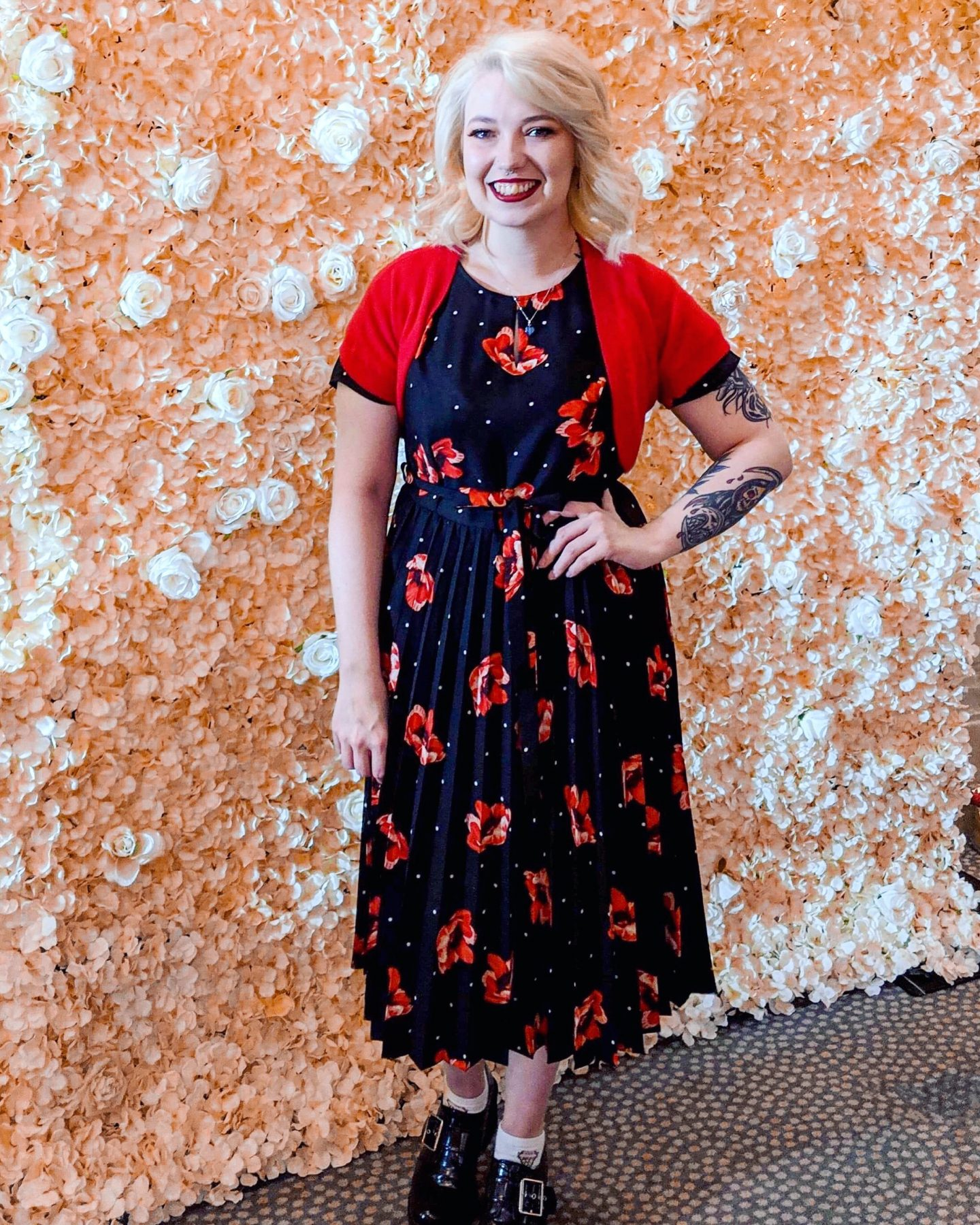 Blonde girl in black and red floral dress at first blogging event