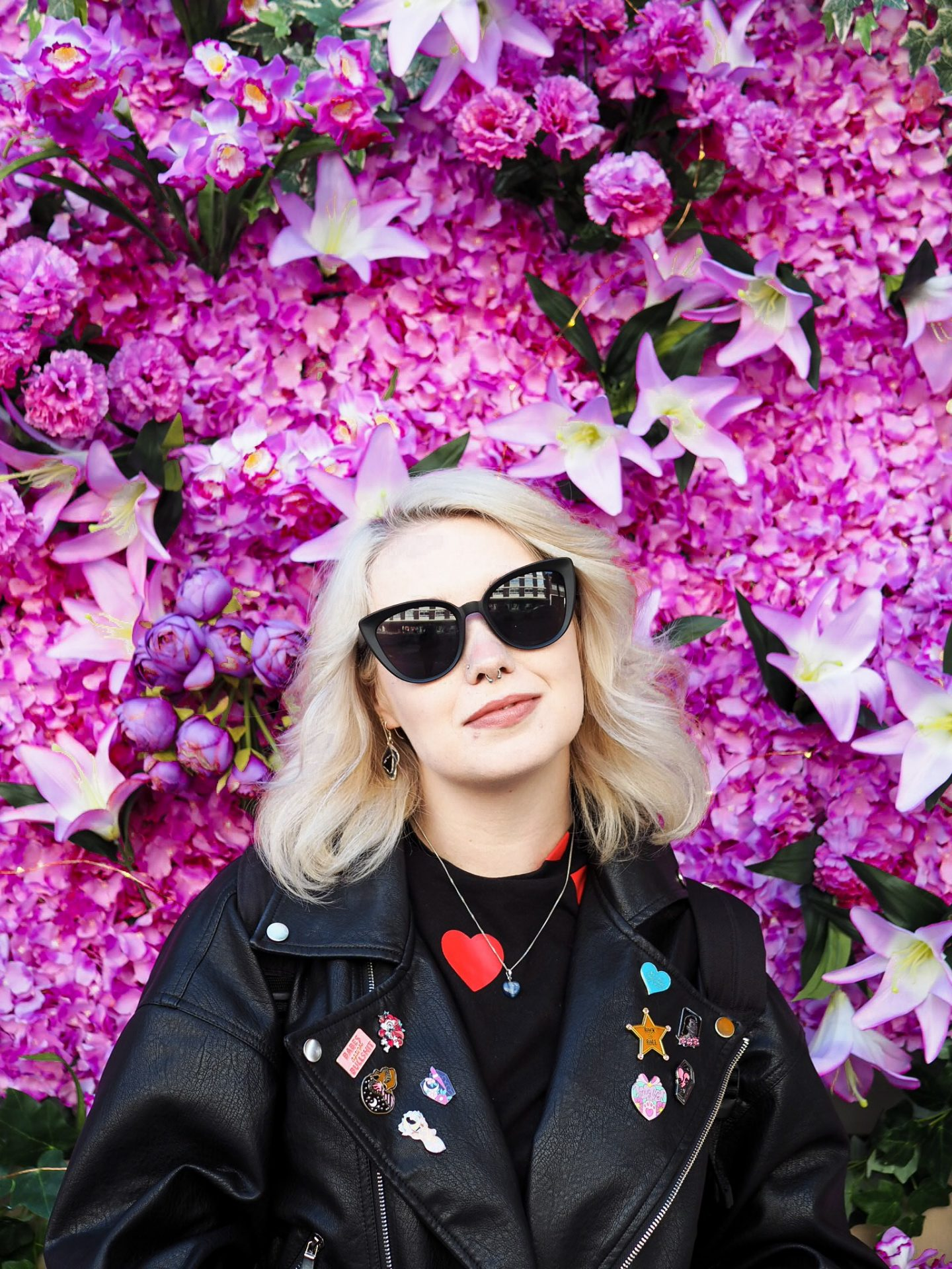 positive things image: blonde girl infront of flowers