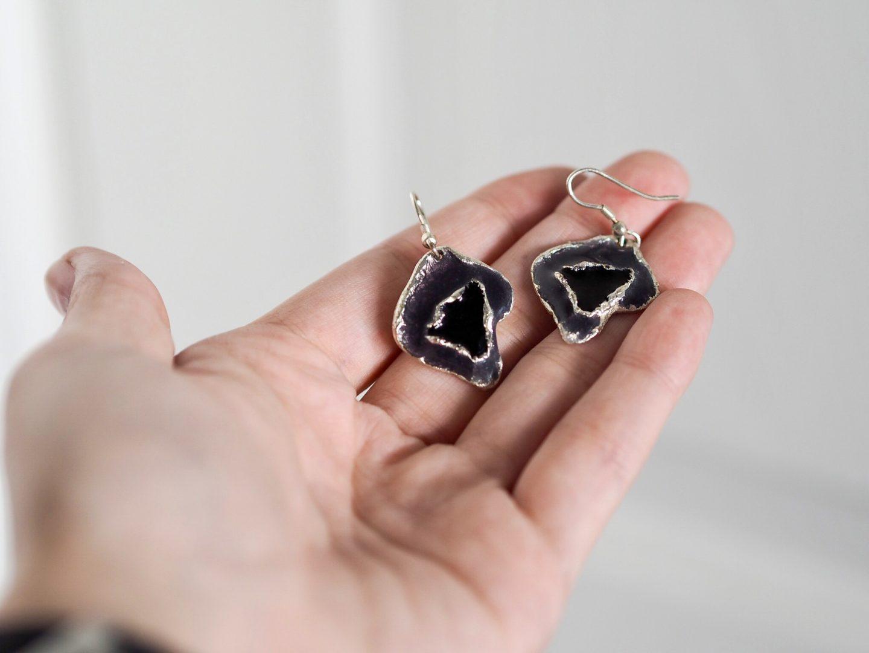Pair of agate earrings in hand