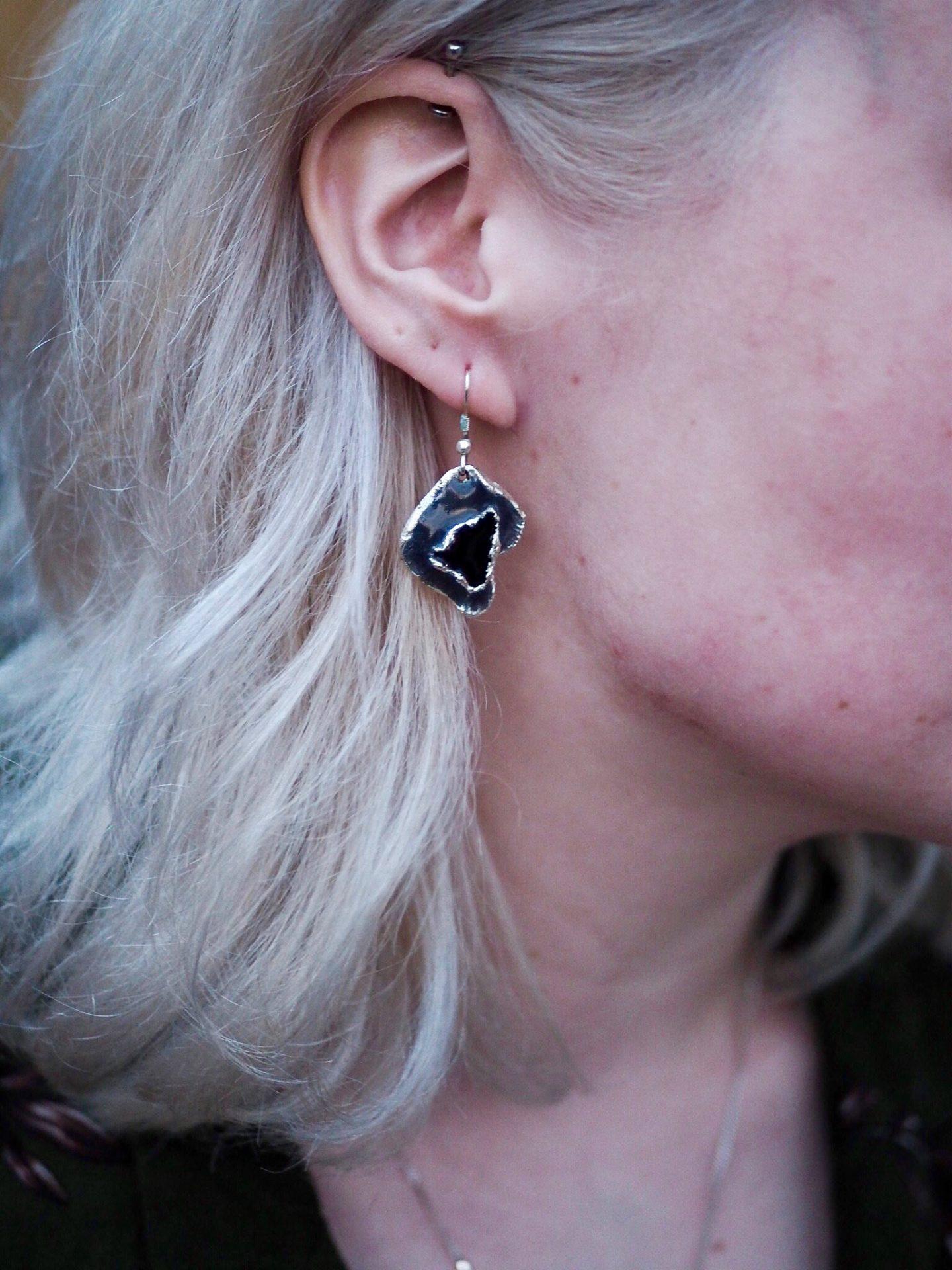 Agate earring in ear