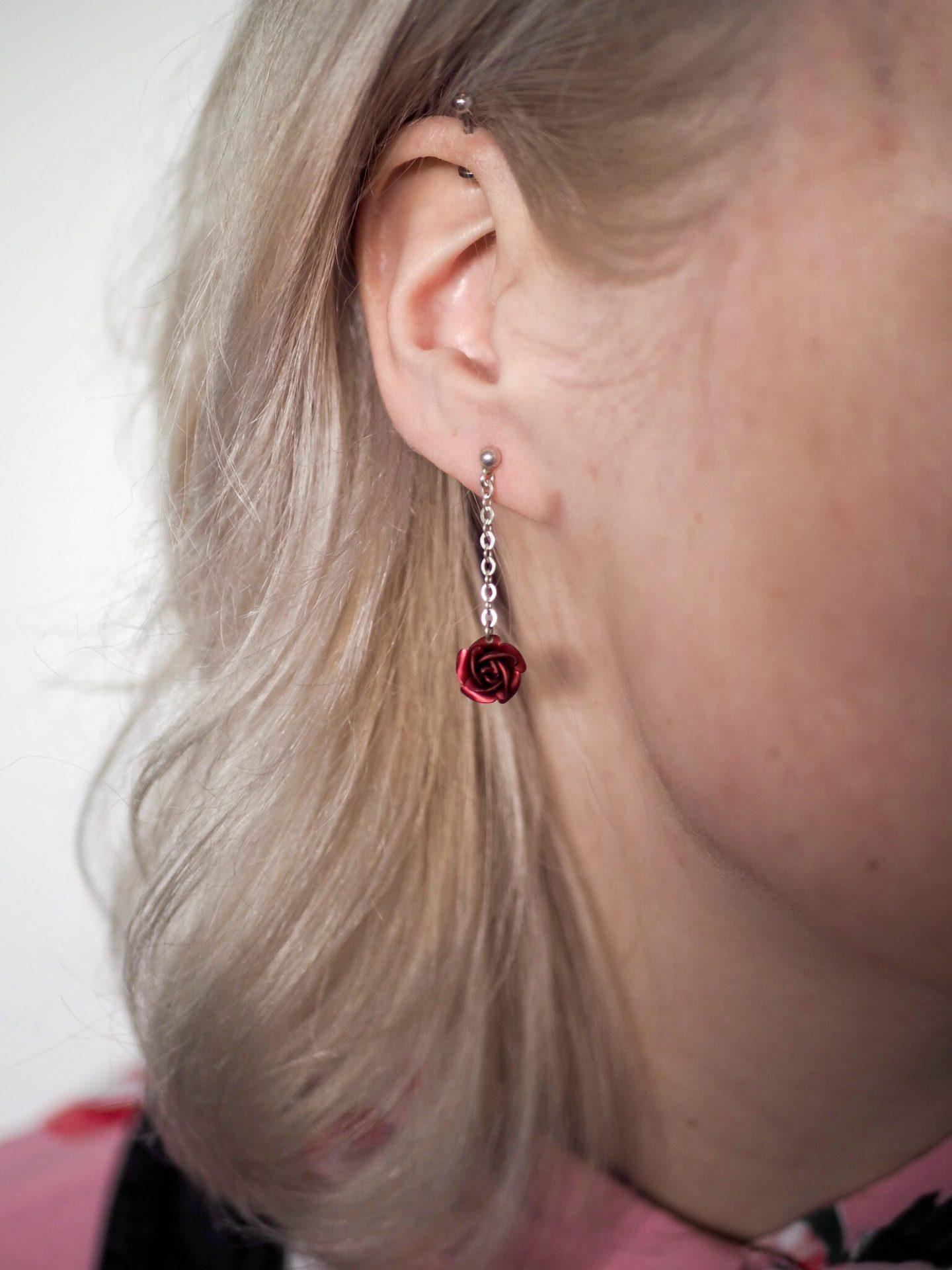 Rose earring in ear